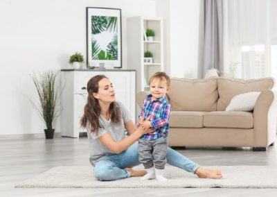 Mother with baby boy playing at home